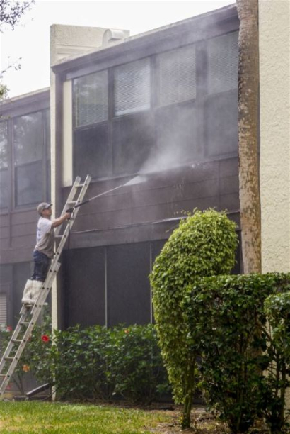 Power washing a commercial exterior in Tallahassee Florida