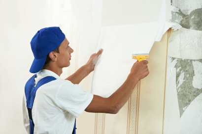 Removing wallpaper to prep for painting interiors in Tallahassee Florida